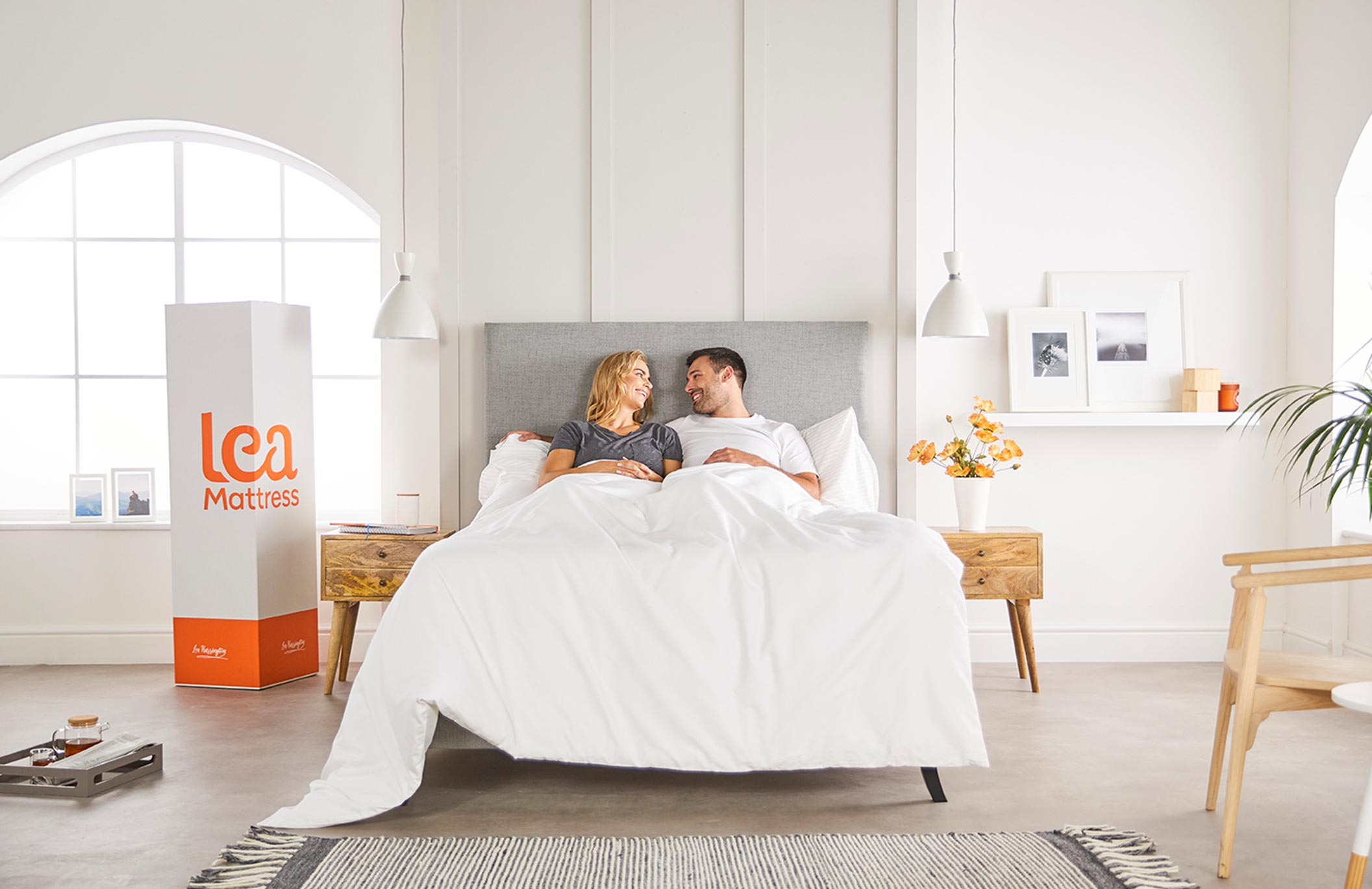 couple in bed on new mattress